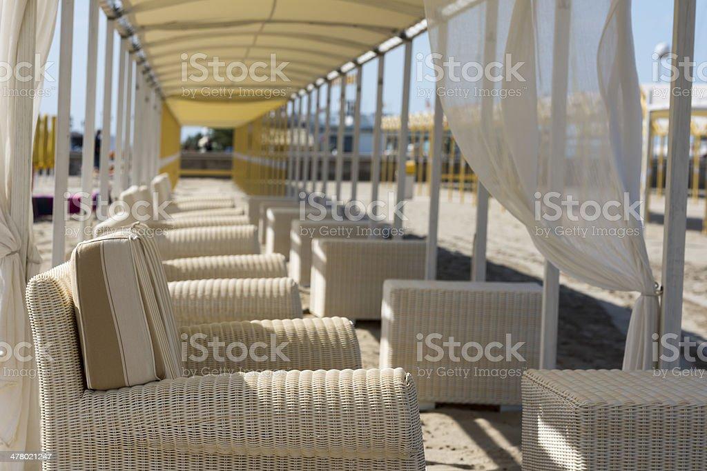 Furniture on the beach stock photo