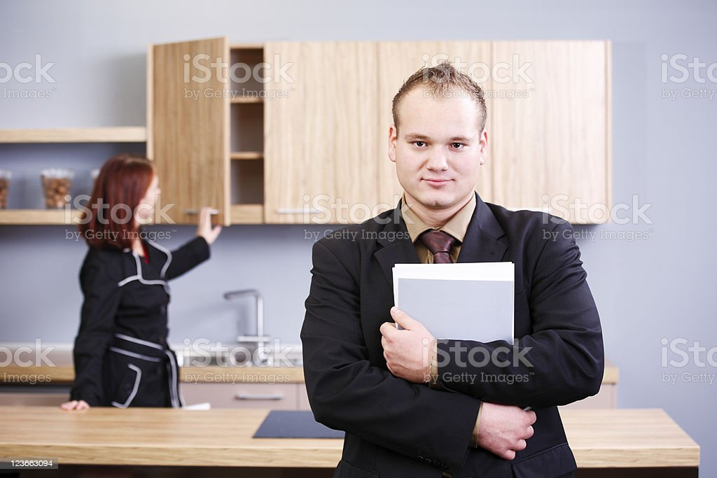 Furniture salesman and a customer royalty-free stock photo