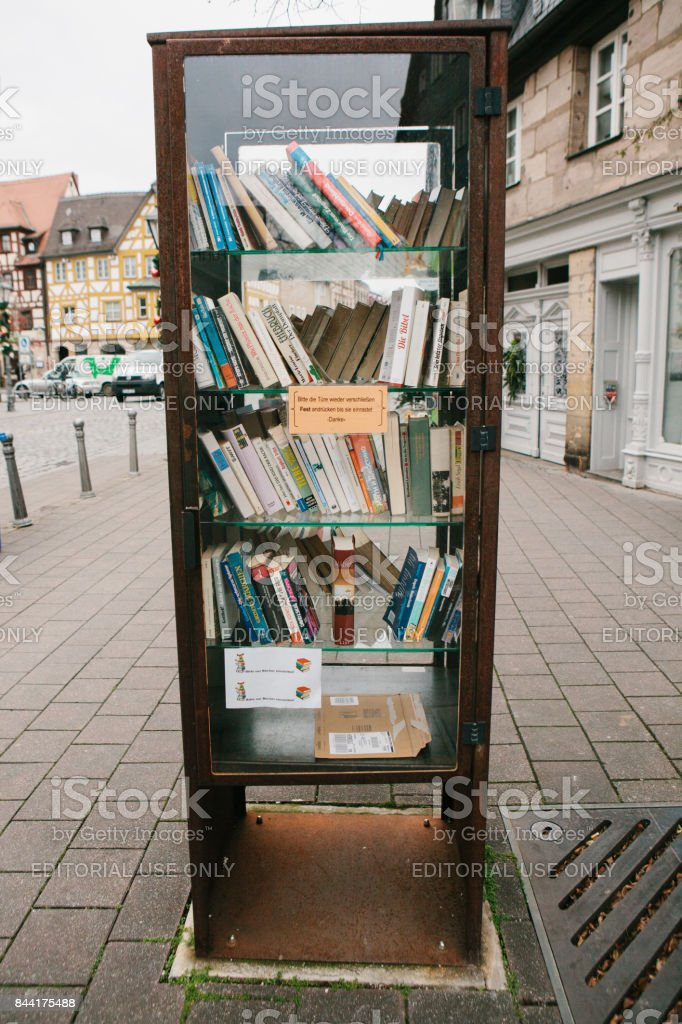 Furth, Germany, December 28, 2016: Books. Street public library. Education in Germany. Lifestyle. Everyday life in Europe. Bookshelves. stock photo