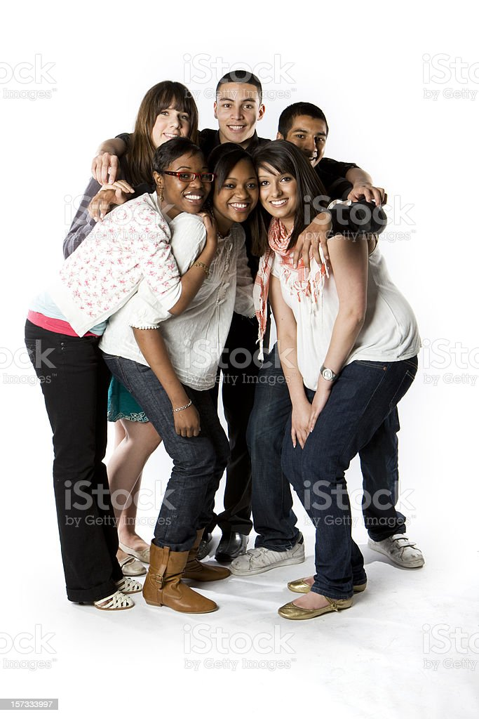 further education: bright smiles and eye contact from teenage friends royalty-free stock photo