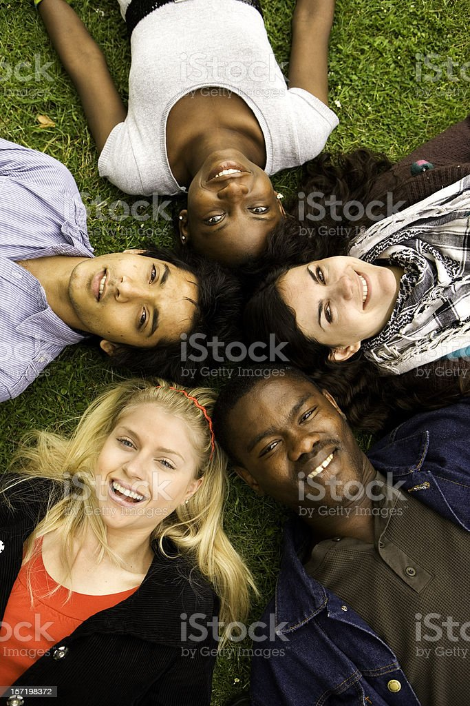 further education: circle of diverse teenage friends with bright smiles royalty-free stock photo