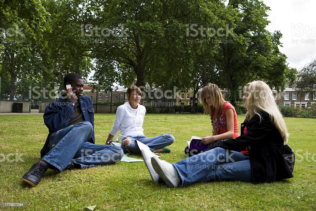further education: diverse friends taking a break from class royalty-free stock photo