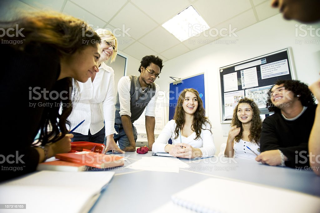 further education: diverse group class project with teacher supervising royalty-free stock photo