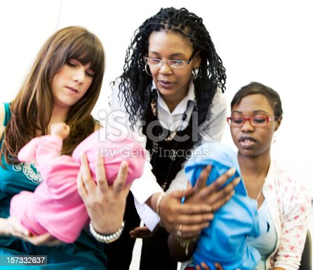 istock further education: nursery nurse students under supervision from their teacher 157332637