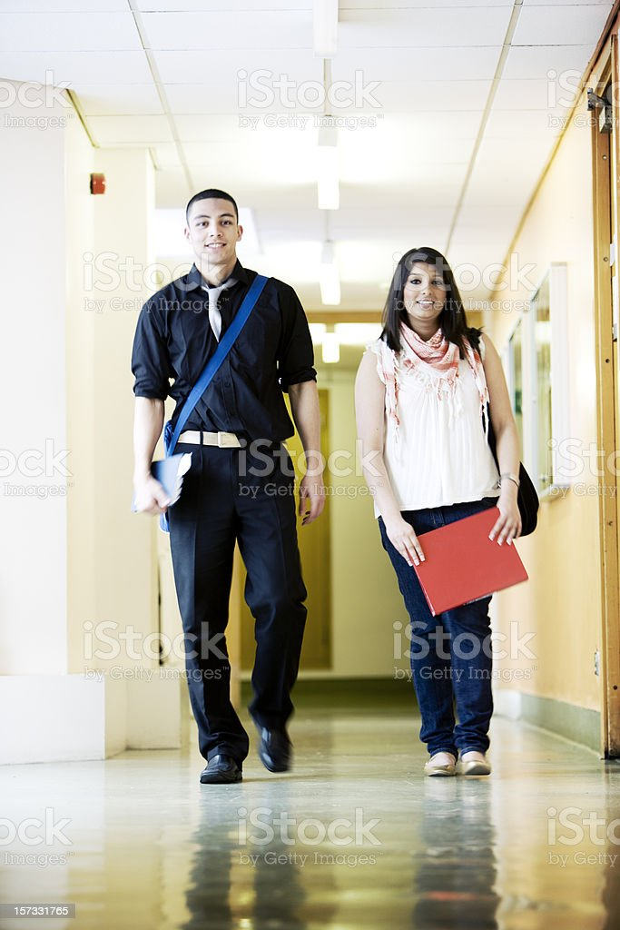 further education: school friends walking the school corridor to class royalty-free stock photo