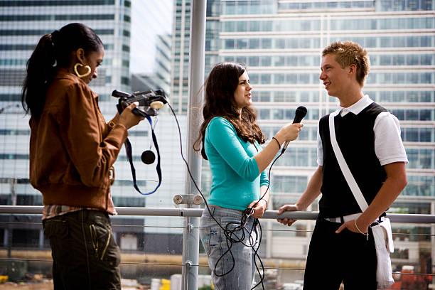 further education: teenage students gaining media and interview experience stock photo