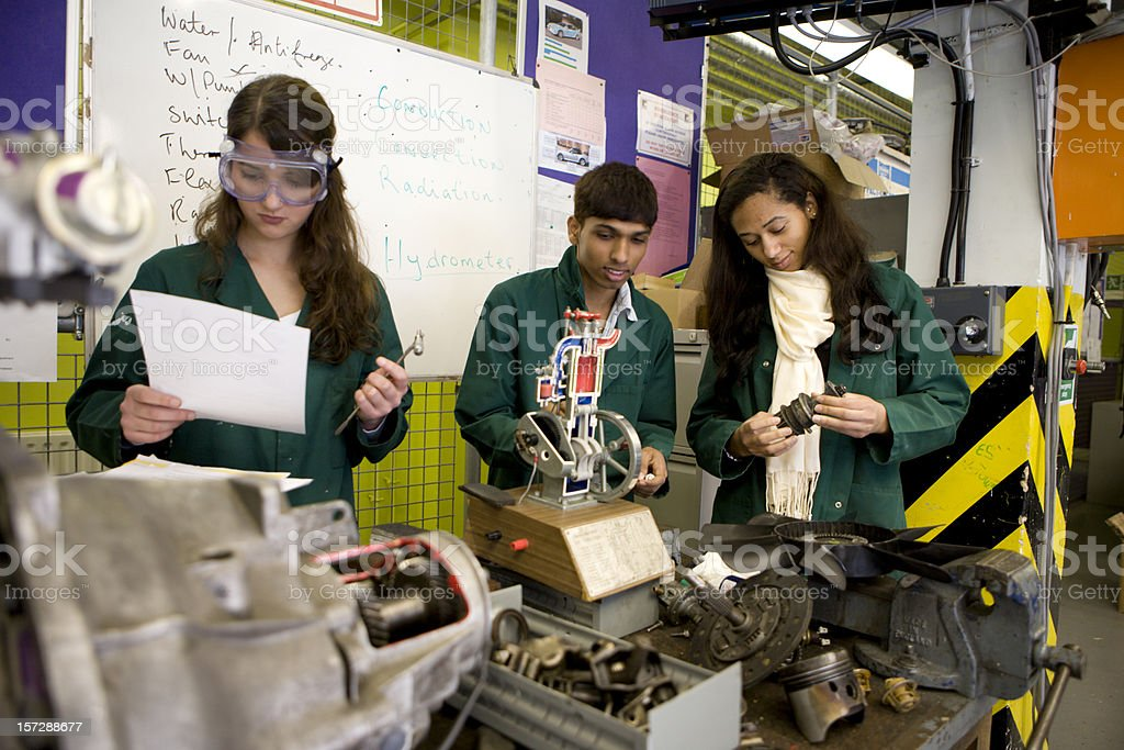 further education: teenage students studying mechanical engineering in the workshop royalty-free stock photo
