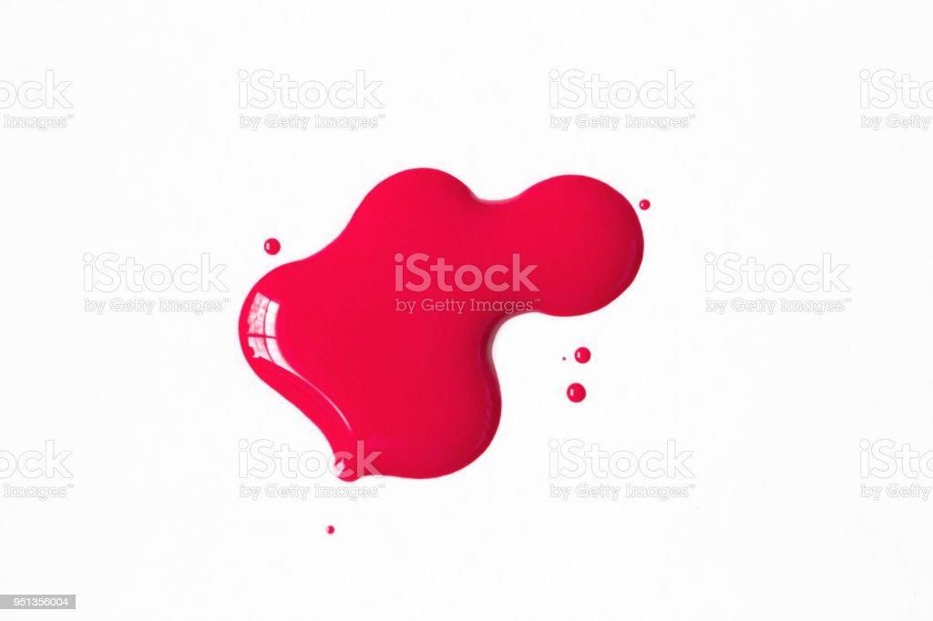 Fuschia Nail Polish Splatter On White Background stock photo