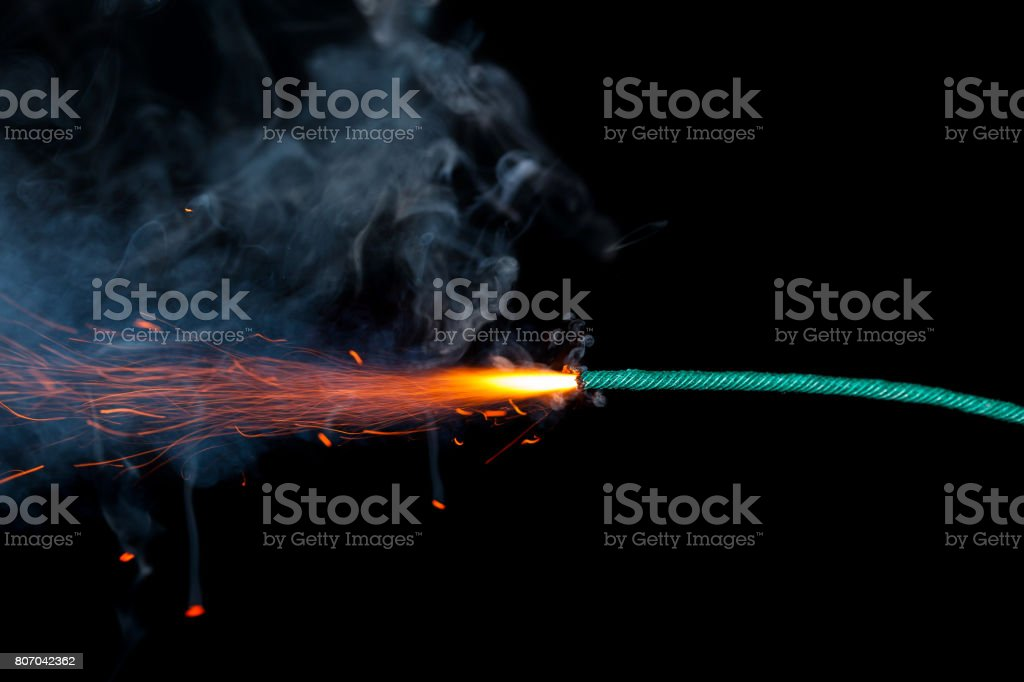 Fuse burning on black background isolated royalty-free stock photo