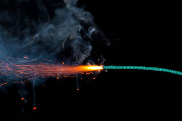 Fuse burning on black background isolated stock photo