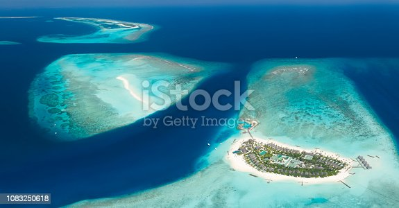 Beautiful huge aerial of the islands and sandbars of the stunning Fushifaru Lhaviyani Atoll, Maldives. Converted from RAW