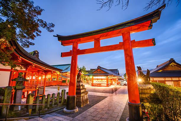Fushimi Inari Shrine of Kyoto Kyoto, Japan- November 23, 2015: Motion blur of visitors at Fushimi Inari Taisha Shrine. The shrine is noted for its numerous torii gates. shinto shrine stock pictures, royalty-free photos & images