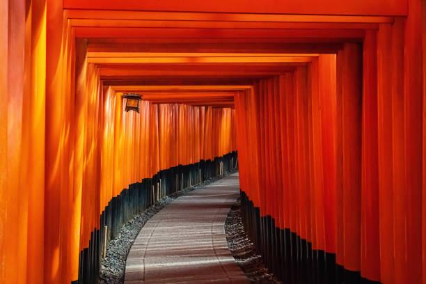 Fushimi Inari Taisha Shrine Torii Gates in Kyoto, Japan Kyoto, Japan - November 20th, 2018 : Red Torii Gate at Fushimi Inari Shrine, a pathway of thousands of torii gate, in Kyoto, Japan torii gate stock pictures, royalty-free photos & images