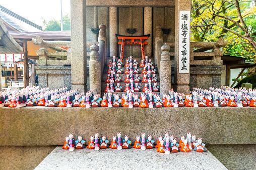 Fushimi Inari-taisha shrine and white foxes of Inari
