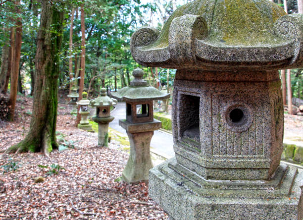 Fushimi Inari-Taisha Shrine, Kyoto Stone lanterns at the Fushimi Inari-Taisha Shrine in Kyoto, Japan. It is famous for it's thousand or so vivid vermilion colored torii gates and is the most important Inari Shrine in Japan. shinto shrine stock pictures, royalty-free photos & images