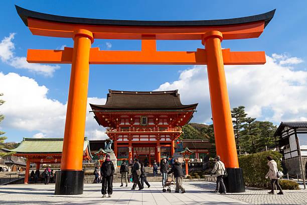 Fushimi Iniari Shrine in Kyoto, Japan Kyoto, Japan - December 13, 2014: Big orange gate at the Fushimi Inari Shrine and people visiting shinto shrine stock pictures, royalty-free photos & images