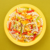 Top view of yellow dish with macaroni pasta salad on it