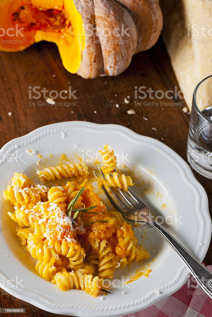 Fusilli Pasta with Orange Autumn Pumpkin Sauce and Grated Cheese royalty-free stock photo