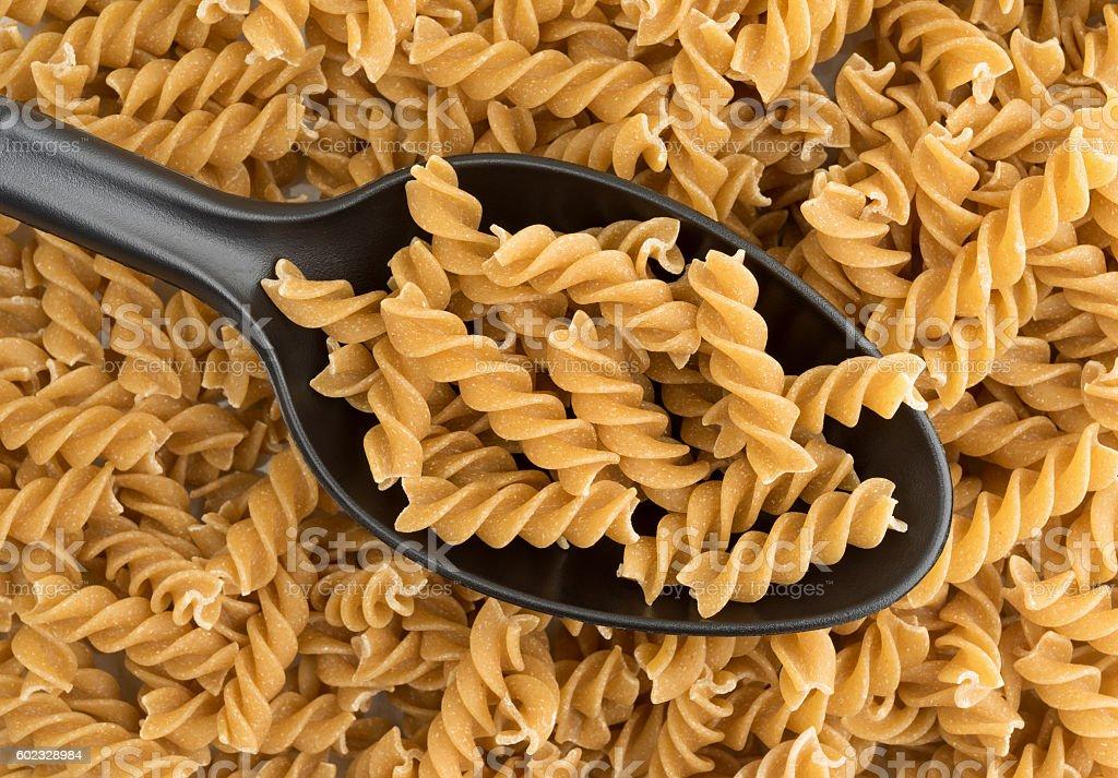 Fusilli whole wheat organic pasta on spoon stock photo
