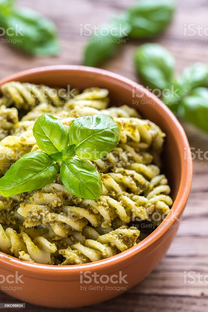 Fusilli with pesto sauce on the wooden background stock photo
