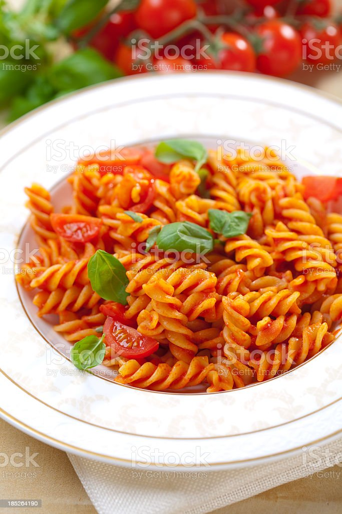Fusilli with tomato sauces and basil stock photo