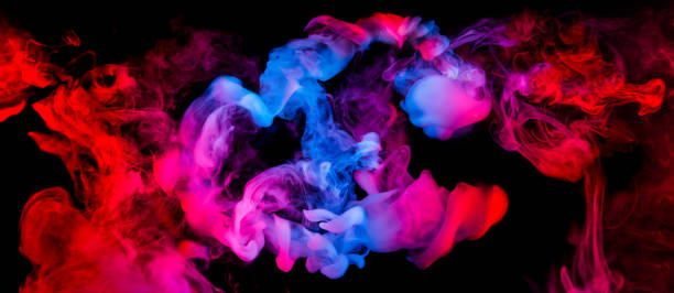 fusion of blue and red smoke in motion stock photo