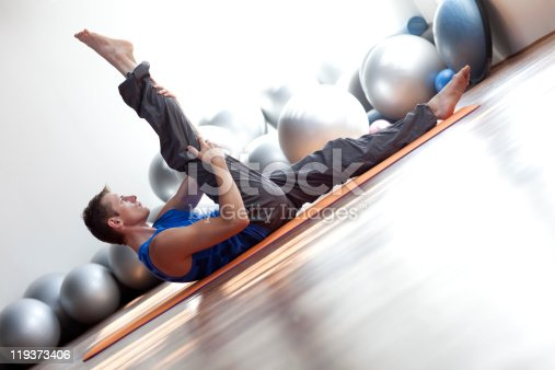 511849865 istock photo fusion of mind and body - man practicing pilates 119373406