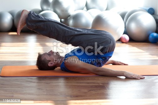 511849865 istock photo fusion of mind and body - man practicing pilates 119430328