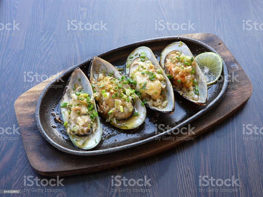 fusion seafood - new zealand mussel in galic stock photo