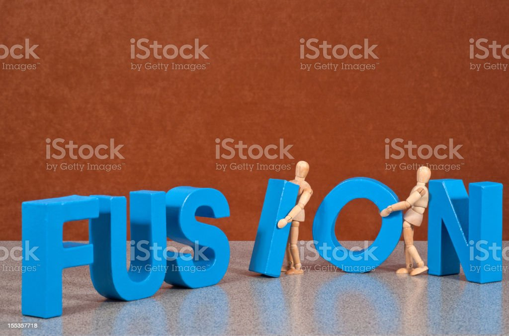 Fusion - Wooden Mannequin demonstrating this word stock photo