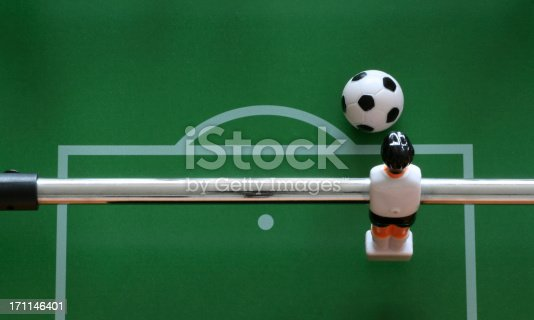 close-up of a goalkeeper from a table soccer game ready to kick the ball