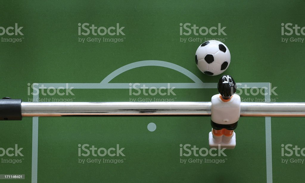 Fussball goalkeeper ready to kick the ball, seen from above stock photo