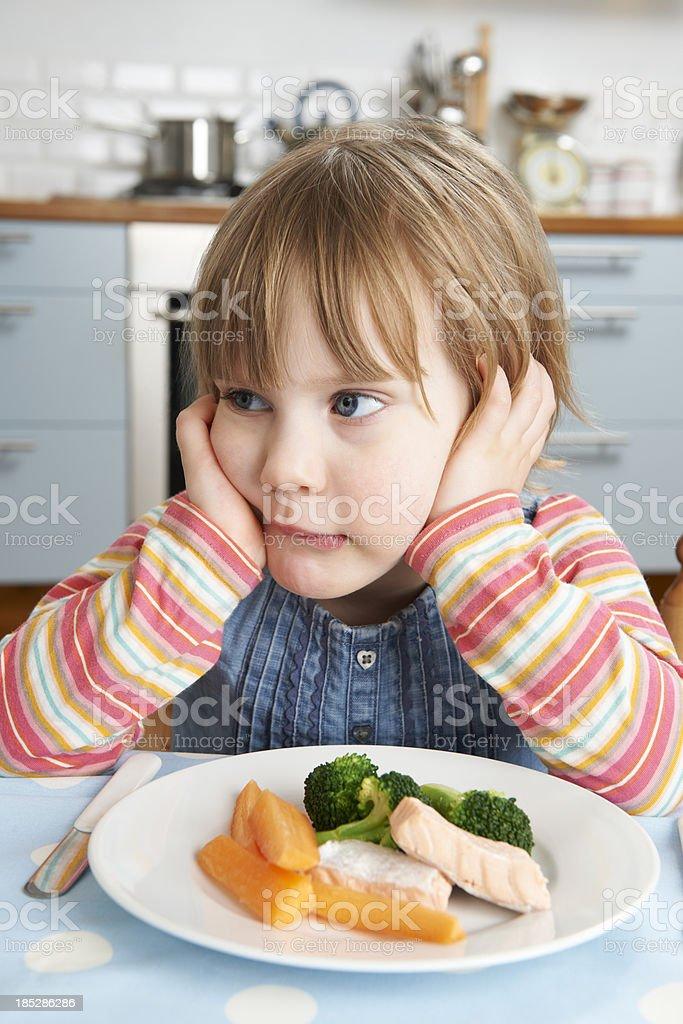 Fussy Young Girl Not Eating Healthy Lunch stock photo