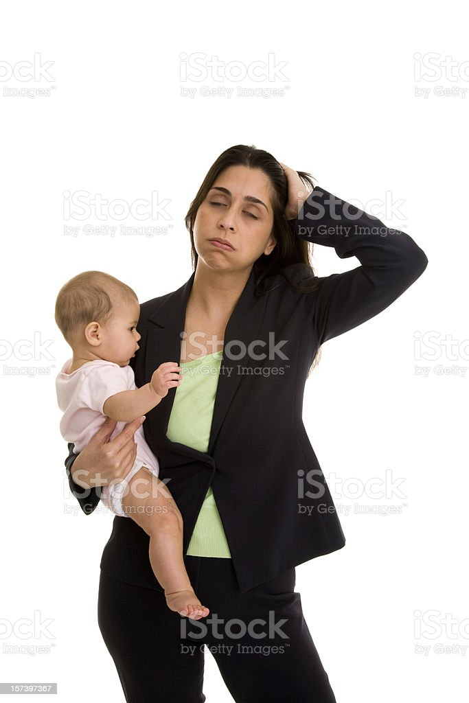 Fustrated mid adult businesswoman holding infant royalty-free stock photo