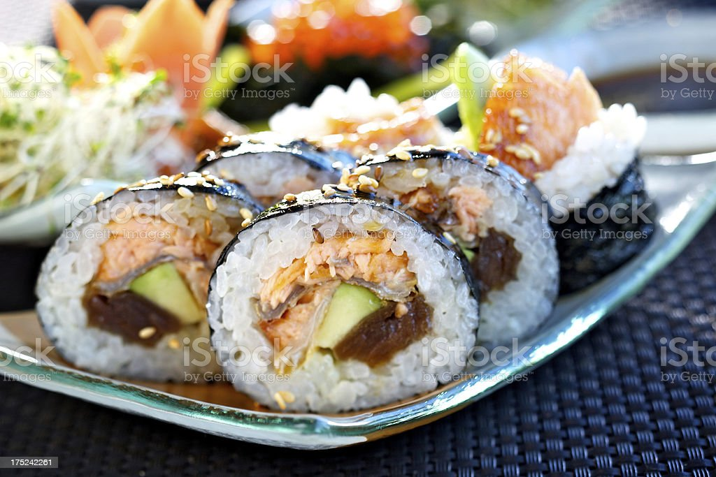Futomaki sushi with roasted salmon royalty-free stock photo