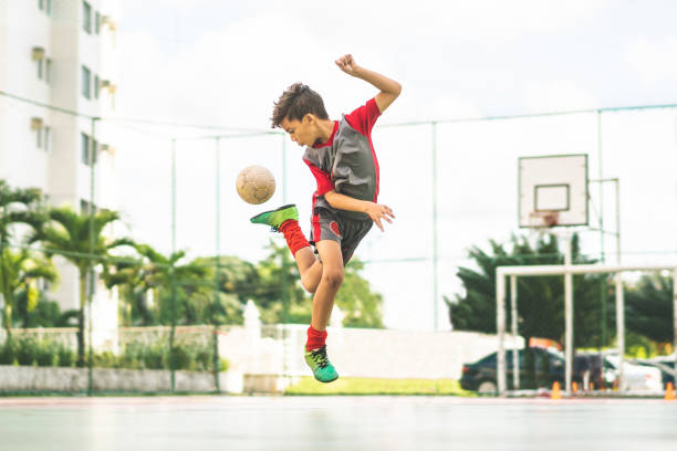 Futsal Soccer - Sport, Boys, Sport Court, Skill, Motion jump shot stock pictures, royalty-free photos & images