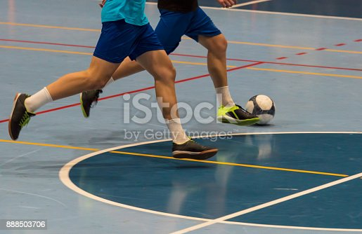 istock Futsal player  sports hall 888503706