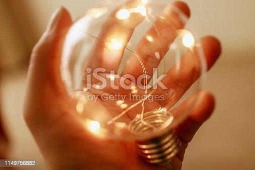 A man is holding light bulb