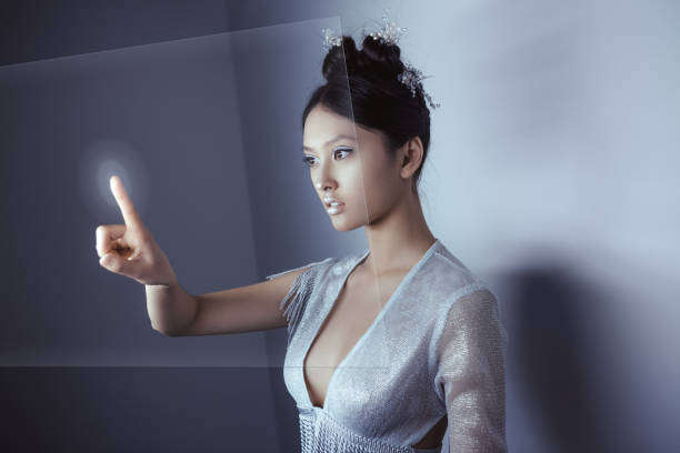 future concept. young pretty asian woman touching digital hologram - business woman hologram imagens e fotografias de stock