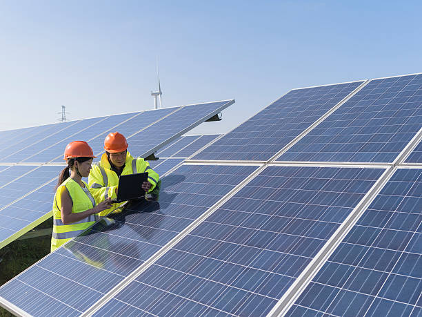 Future electrical production, asian engineers workers at a renewable energy plan, young asian engineers  working in  solar power station. power occupation stock pictures, royalty-free photos & images