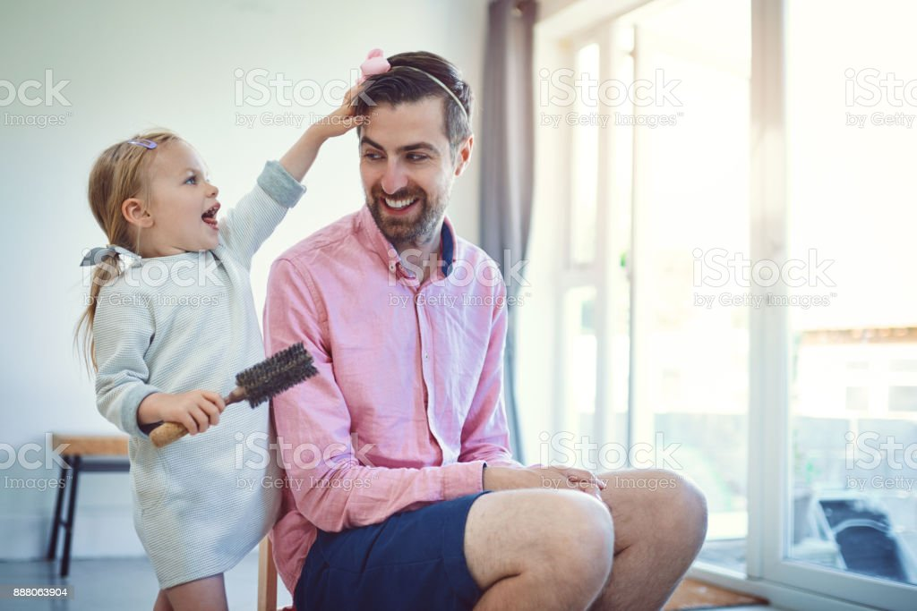 Future hairstylist in the making stock photo
