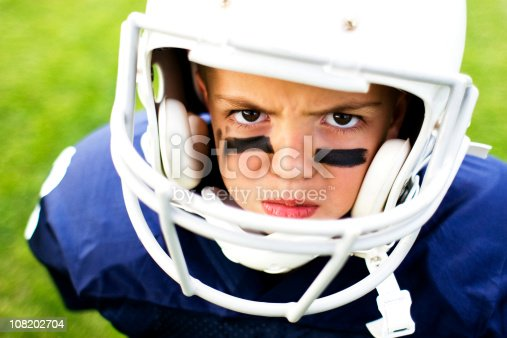 A young football player shows his tough mentality.
