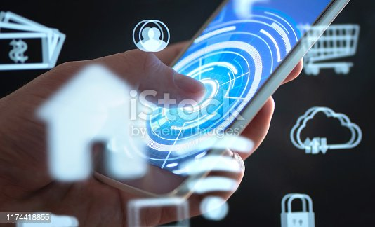 istock Future mobile phone technology to control smart home. Cellphone app interface with abstract IOT and AR data. Futuristic augmented reality tech in smartphone. 1174418655