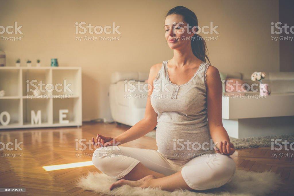 Future mother exercise yoga. stock photo