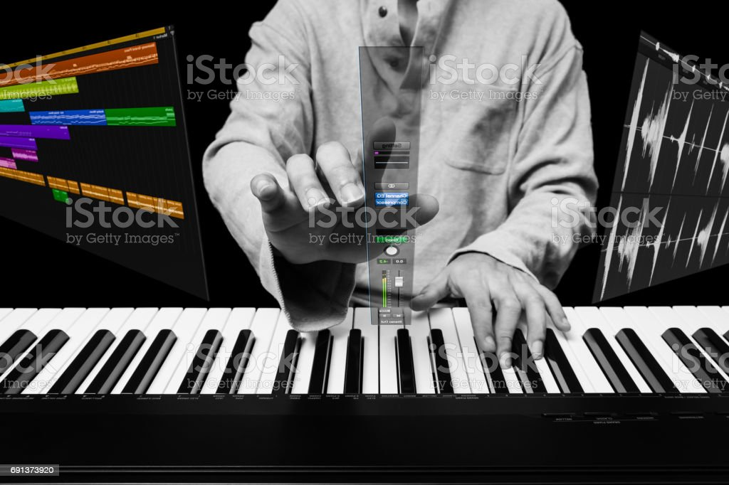 future music technology concept, male pianist or composer touch floating mixer page stock photo