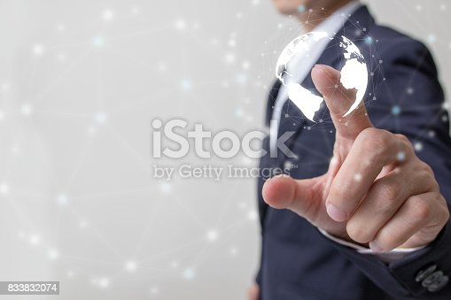 586932042 istock photo Future of financial business concept,Businessman touching increasing graph with finance symbols coming. 833832074