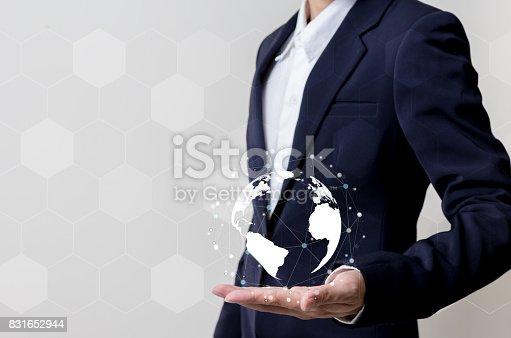 istock Future of technology network concept,Businessman holding worldwide network symbols. 831652944