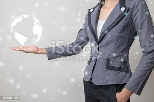 istock Future of technology network concept,Businessman holding worldwide network symbols and graphical interface. 833831986