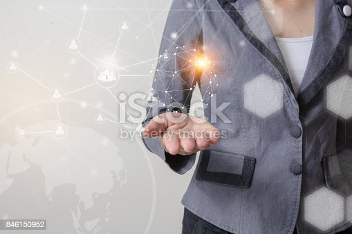 istock Future of technology network concept,Businessman holding worldwide network symbols and graphical interface. 846150952