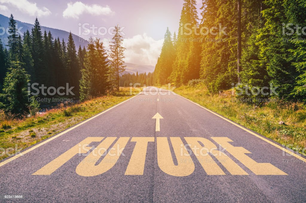 Future text on road against asphalt background in nature. stock photo
